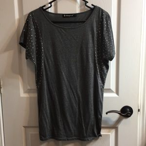 Grey winged arm top with studded arm details!